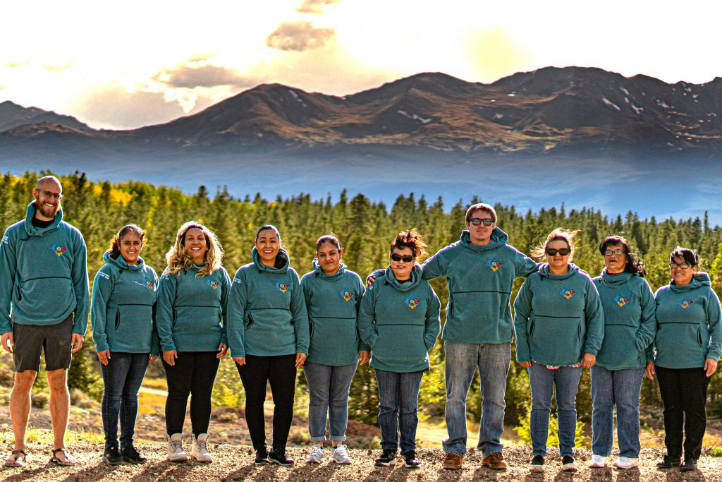 Lake County Build a Generation staff members and volunteers with the Manufactured Housing initiative in front of the Sawatch Range.